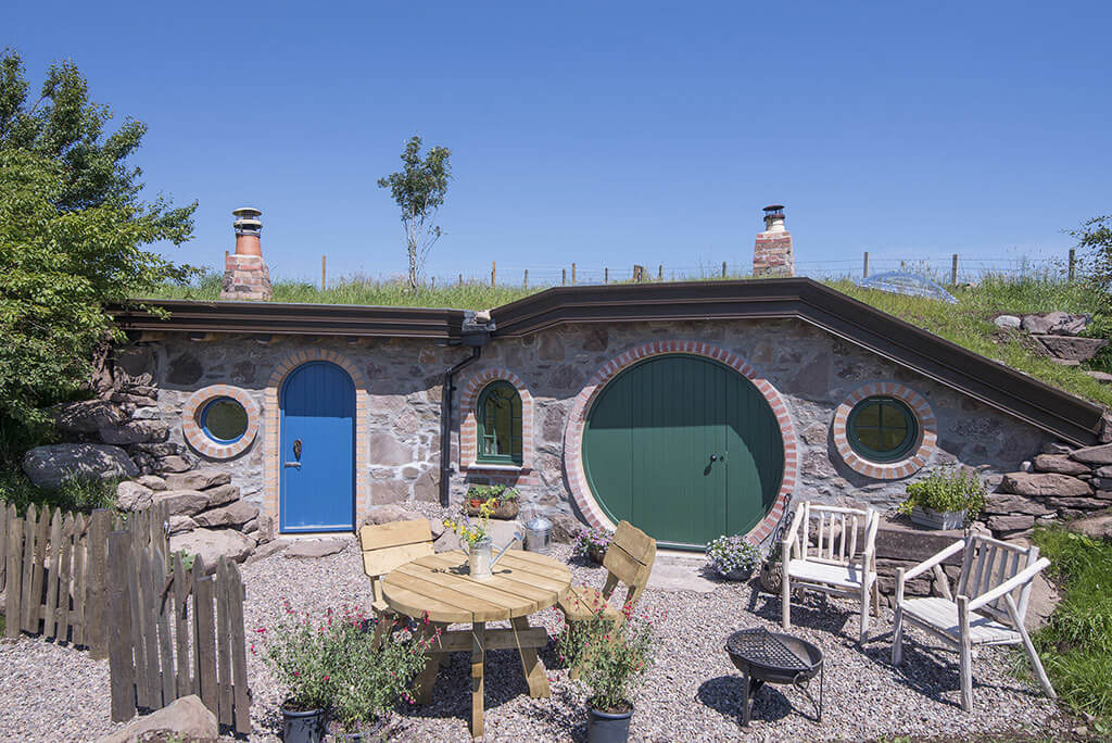 Unique hobbit hole glamping cottage with green door